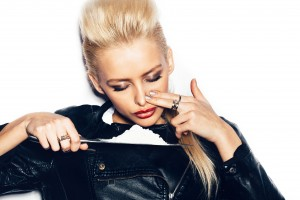 Swag girl in black leather jacket sniffing cocaine (imitation flour). White background not isolated